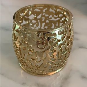 Jewelry - Heavy metal gold plated cuff with design.